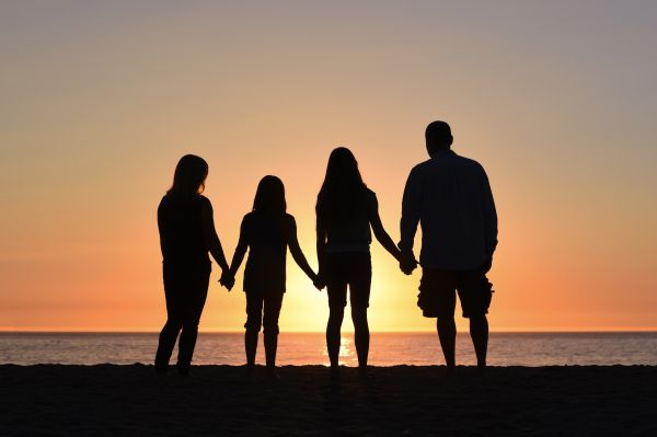 Silhouette of family by the sea
