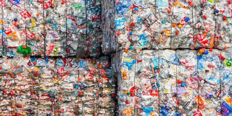 Piles of plastic rubbish stacked up in cubes
