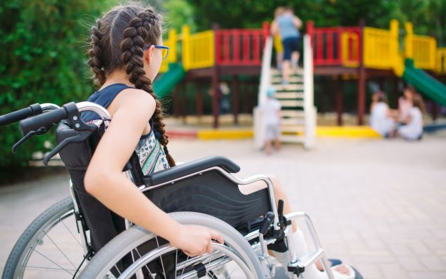 Young person sitting in a wheelchair
