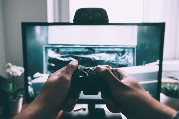 A person's hands using a games console
