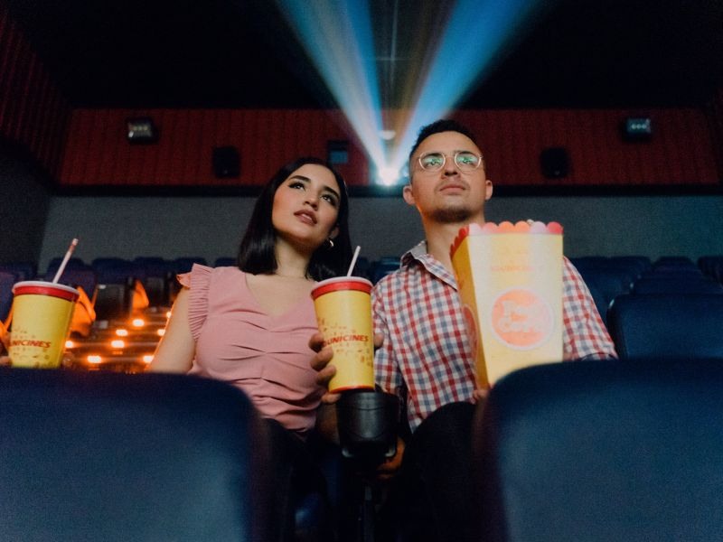 Two people in a cinema watching a movie