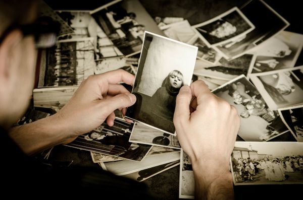 Man looking through old black and white photos