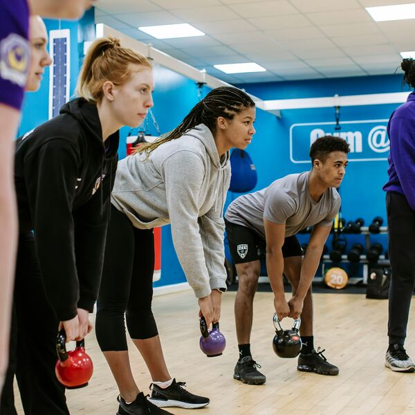 A group of people exercising in the gym