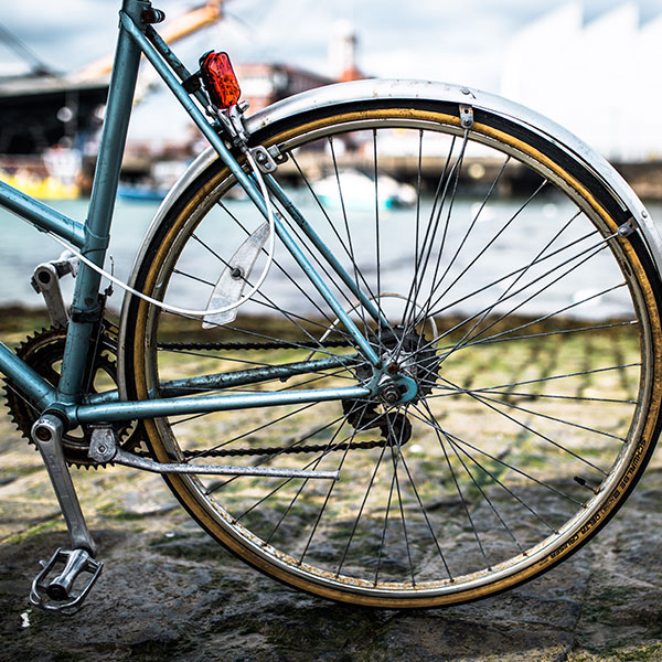 bicycle wheel on cobbled street