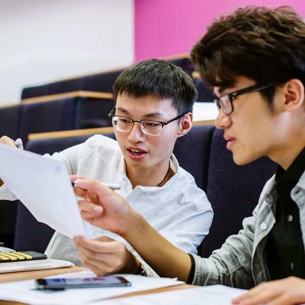 Students discussing notes in pre-sessional English session