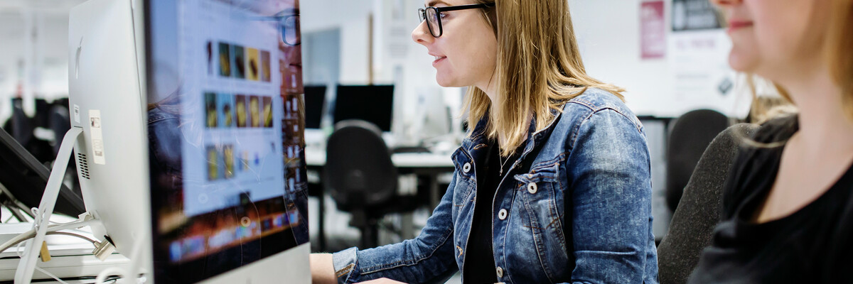 Female student using Eldon computer suite